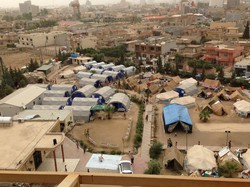Winterized tents on the grounds of the Chaldean Church in Erbil, Iraq, house displaced persons fleeing the advance of ISIS in Mosul and other northern cities.